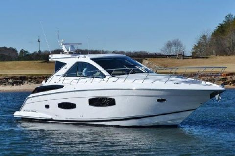 2015 Regal 53 Sport Coupe Starboard profile at the golf course