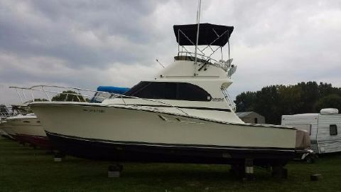 1990 Luhrs 320 Convertible Port Side