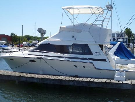 1991 Luhrs 3420 Motor Yacht Port Beam at the Dock