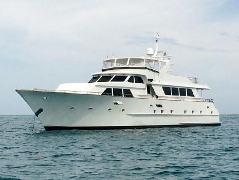 1987 Broward Raised Pilot House Motor Yacht Anchored in the Bahamas