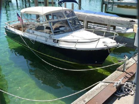 1984 Shamrock Cuddy Cabin Starboard Side at Dock